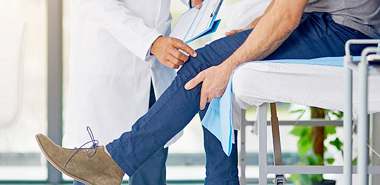 A doctor examining a patient's knee